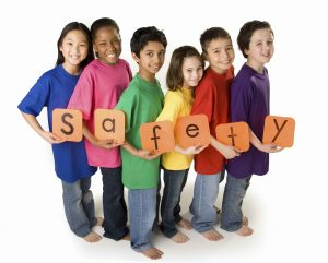 Picture of children holding safety letters spelled out