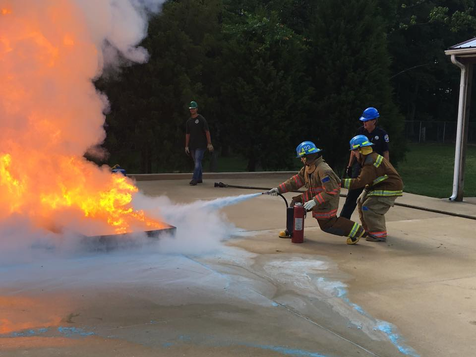 Photo of trainee putting out fake fire